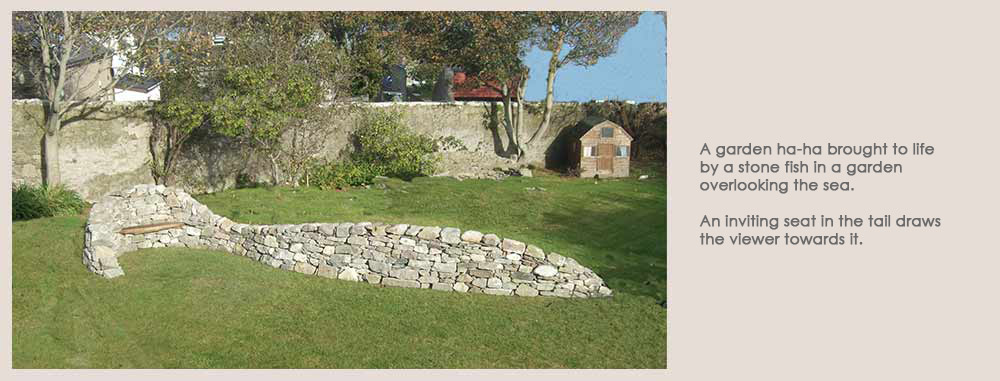 A garden ha-ha brought to life by a stone fish in a garden overlooking the sea
